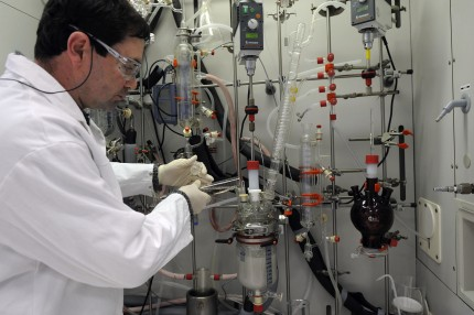 A laboratory technician measures chemicals into a beaker at the company's lab, France, on Tuesday, Feb. 10, 2009.