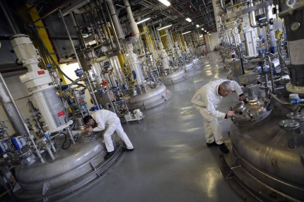 Workers checking the cleanliness of a reactor in a laboratory. France, on Tuesday, Feb. 10, 2009.
